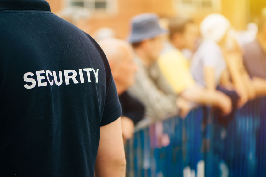 security guard working at public event,