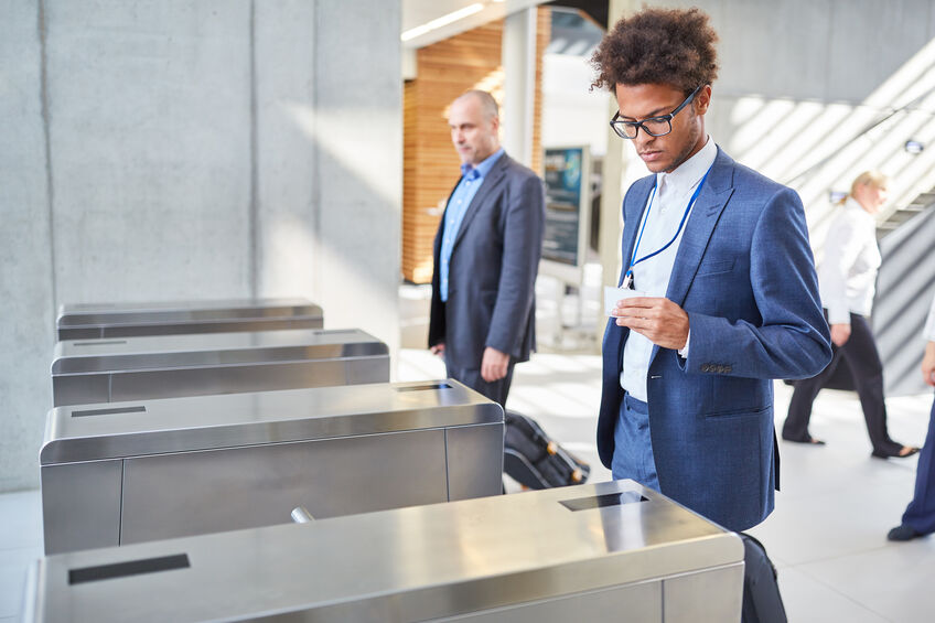 Young businessman checking in at a security gate